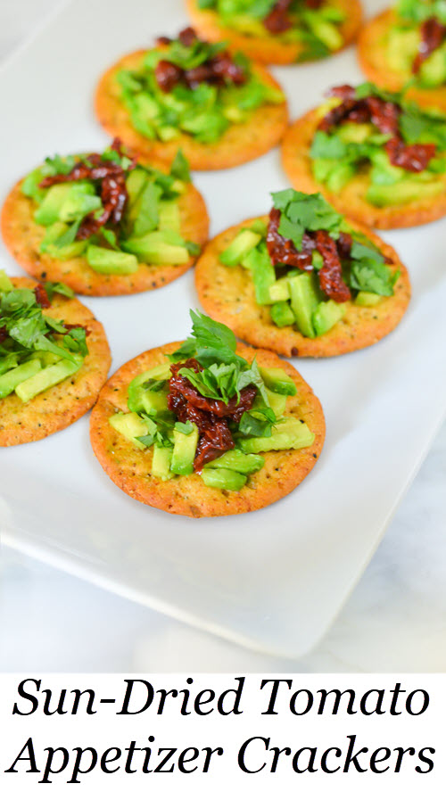 Sun-Dried Tomato Crackers - Easy Appetizer Recipe. Sun-Dried Tomato Avocado Cracker Topping - Easy Appetizer Recipe. Easy appetizer recipe with avocado. #appetizer #appetizers #starters #entertaining #dinnerparty #avocado #sundried #foodblog #lmrecipes