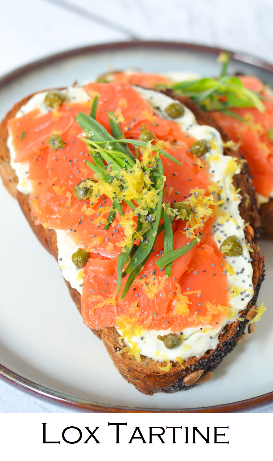 Lox Tartine Breakfast or Dinner. Whip up this easy smoked salmon tartine for breakfast, lunch, or dinner. Good lox layered over goat cheese on delicious bread! #breakfast #brunch #salmon #tartine #toasts #recipe #foodblog #homemade #foodblogger #lmrecipes