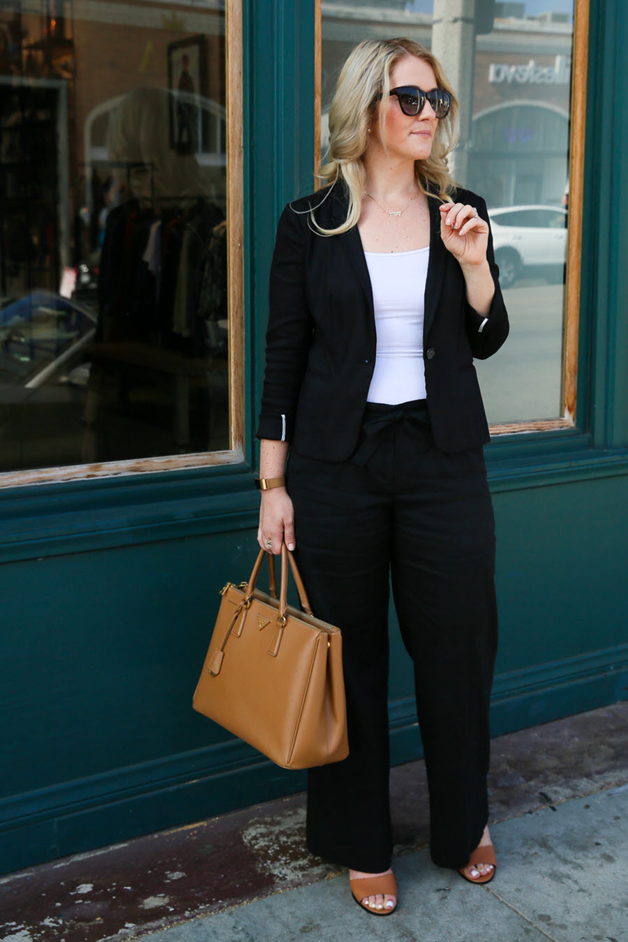 Black Blazer and Wide Leg Pants Outfit for Work. Dress up or dress down the wide leg pants trend with a tucked in shirt and heels. Paired with a matching blazer, this work outfit is great for a girls weekend too. #fashionblog #outfitideas #wideleg #widelegpants #fashiontrend #workoutfit #blazer #blackandwhite #prada