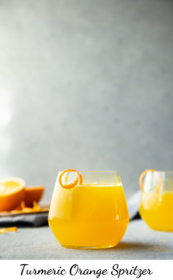 Turmeric Cocktail - Turmeric Orange Spritzer with homemade turmeric spritzer. a delicious make ahead cocktail. A great Thanksgiving and Christmas brunch drink. #spritzer #turmeric #orangespritzer #cocktails #thanksgiving #lmrecipes #christmasbrunch #healthydrinks