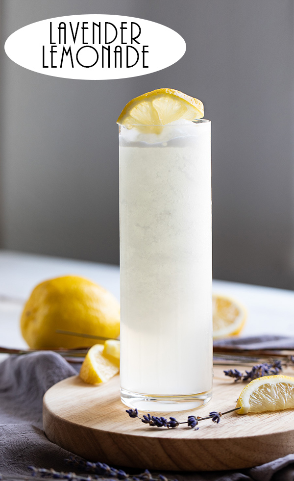 Frozen Lavender Lemonade Recipe. This spring and summer drink is easy and fun for everyone. A slushy recipe for grownups made with fresh lemons and lavender. Serve it at Easter, Mother's Day, Baby Showers, and any summer potluck. #lemonade #lavender #drink #drinkrecipe #foodblog