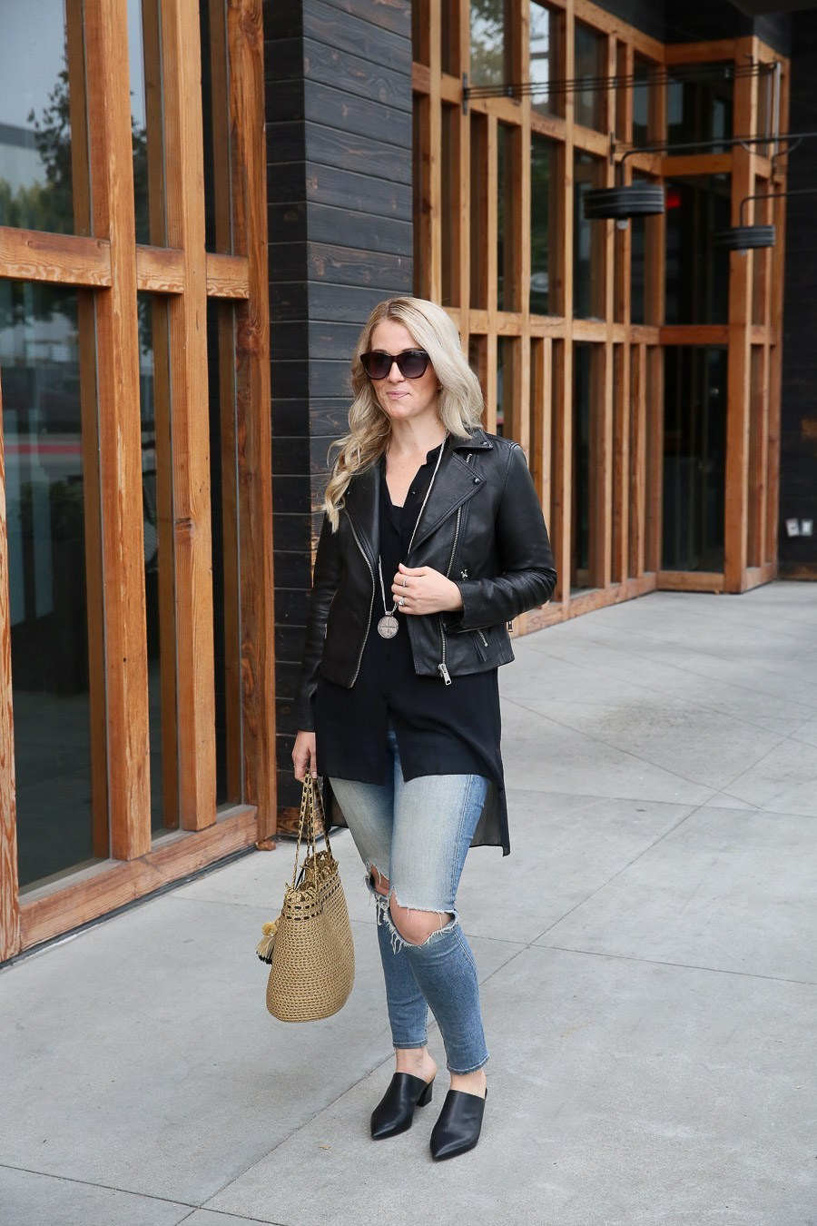 Straw Bag Tote with Ripped Jeans + Leather Jacket