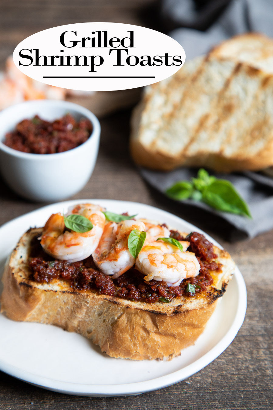 Grilled Shrimp Toast. This easy summer recipe can be made with fresh or cooked shrimp on your indoor grill or out on the bbq! Extra flavor comes from the sun dried tomato spread! #dinner #bbq #shrimp #bread #grilled #recipes