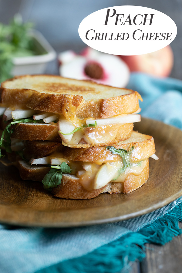 Peach Grilled Cheese. An easy summer lunch idea with fresh fruit. Made with white peaches, smoked cheddar, and arugula, this is a perfect summer treat. #cheese #grilledcheese #lmrecipes #summerdinner #summer #dinner