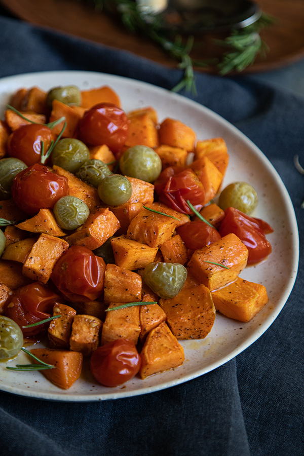 Try this Roasted Sweet Potato Salad this fall. Delicious sweet potatoes combine with tomatoes for a perfectly sweet and acidic sald that can be enjoyed warm or cold. #lmrecipes #vegetarian