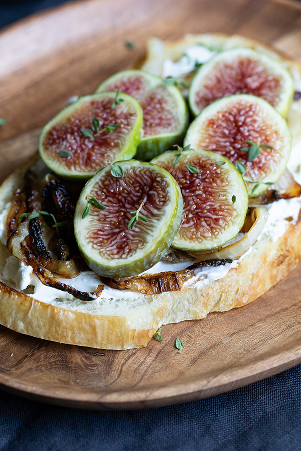 Savory Fig Toast. Delicious sourdough bread toast topped with fresh figs, caramelized onions, and goat cheese! A delicious and easy appetizer, or vegetarian <a href=
