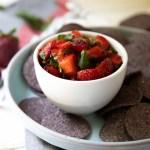 Cilantro Strawberry Salsa in White Bowl with Blue Corn Tortilla Chip Rounds