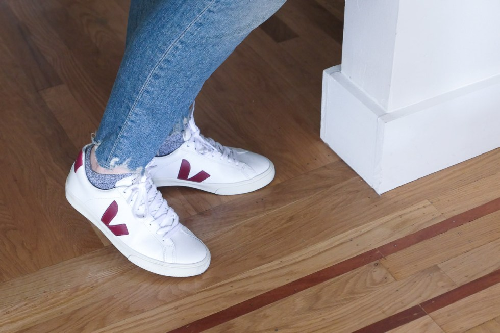 Veja sustainable shoes with distressed blue jeans