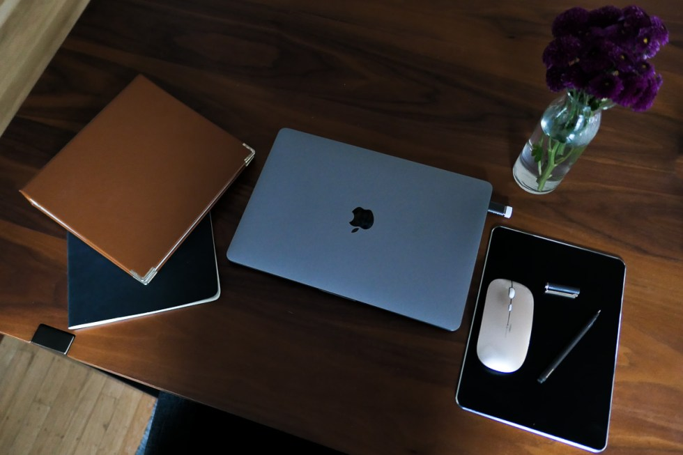 Small Desk Organization Ideas + Products - MacBook Pro w. notebooks and small mouse