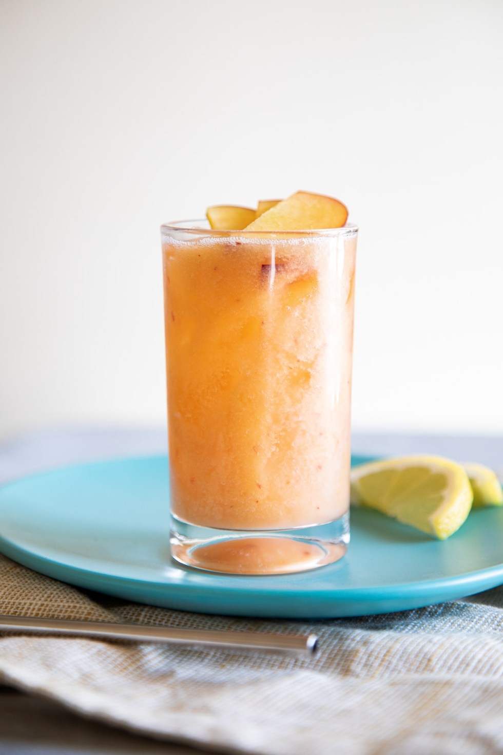 Fresh Peach Lemonade in Glass on Turquoise Plate