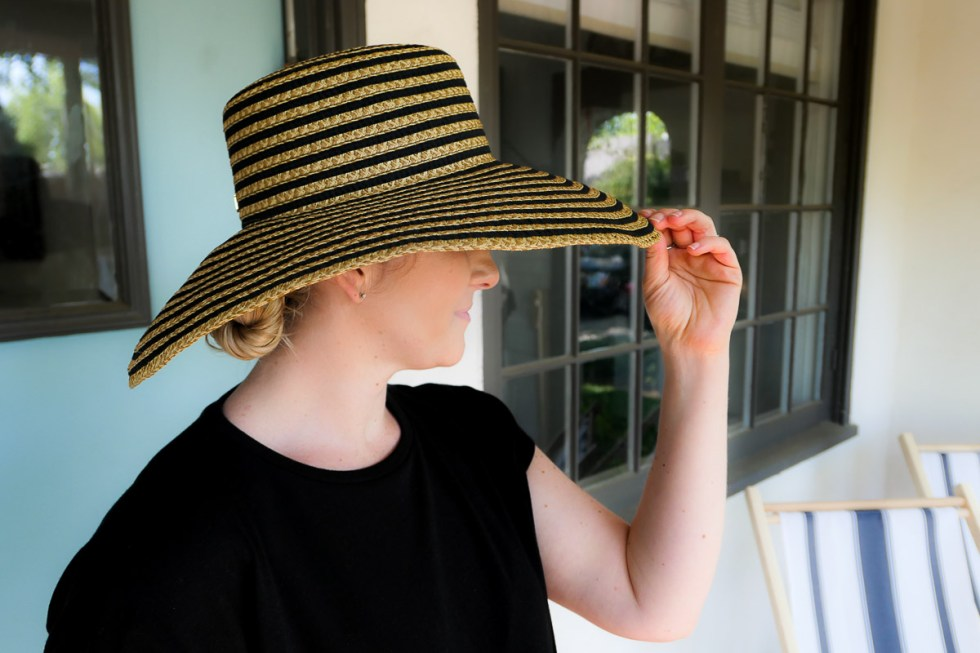 One In One Out Closet Method - Luci wearing black striped Eric Javits Hat