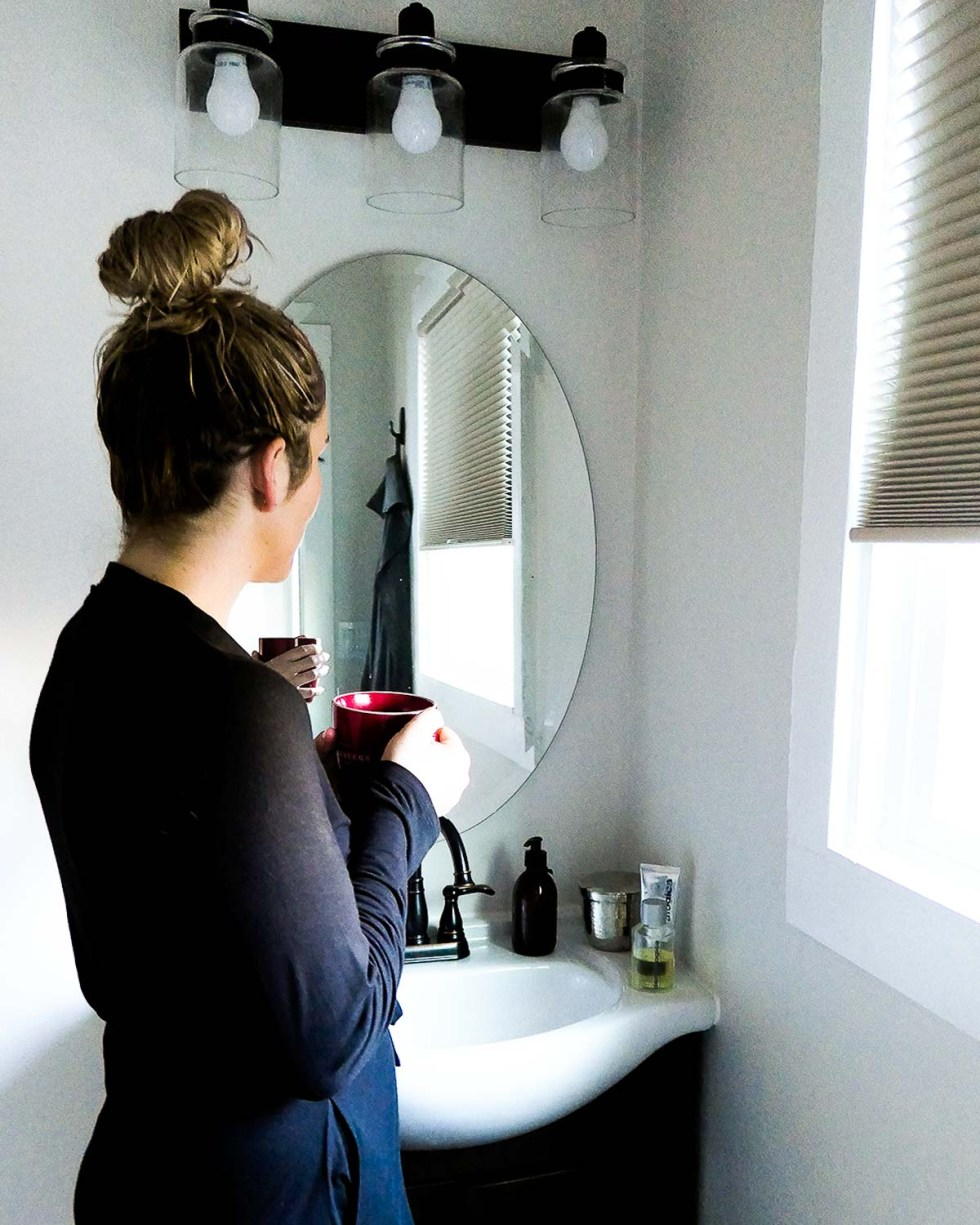 Clean Beauty Hand Creams - Luci Standing by Sink