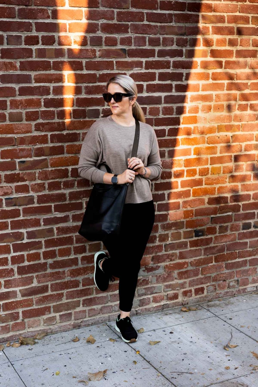 Walking Fall Travel Outfits - Eileen Fisher Sweater + Black Jeans