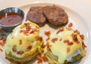 Fried Green Tomato & Bacon Benedict with blue cheese sauce, bacon and Voodoo Sauce™