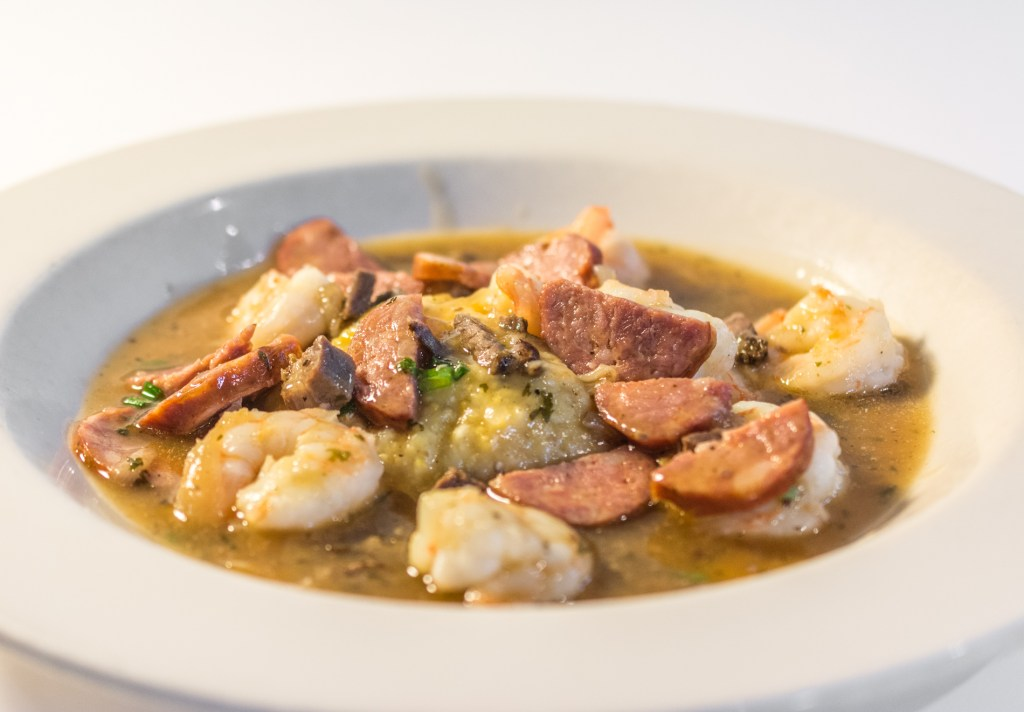 Shrimp and Grits wild-caught American shrimp, andouille sausage, onions and tasso ham gravy over Old Mill of Guilford grits