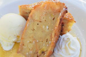 "White Chocolate-Banana Bread Pudding served with vanilla ice cream and warm ""Foster"" sauce"