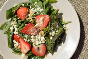 Strawberries and Dandelion Greens tossed with almonds, housemade cheese and strawberry vinaigrette