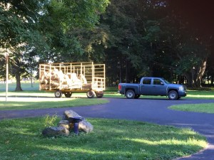 Hay wagon pulls into the driveway.