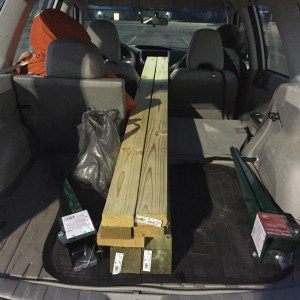 Hauling sign post materials in the Subaru.