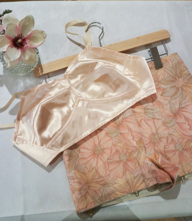 one of the first marks and spencers bras and girdle in peach