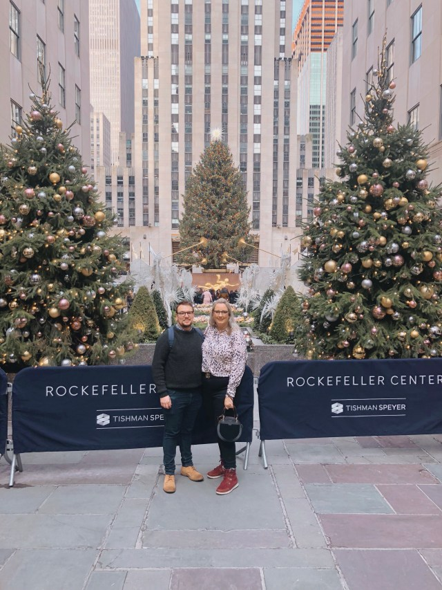 lucy and luke in front of the Rockefeller Tree