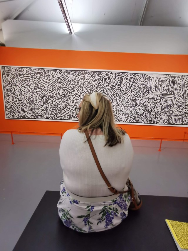 lcy looking at pieces of art from the Keith Haring exhibition at the Tate Liverpool