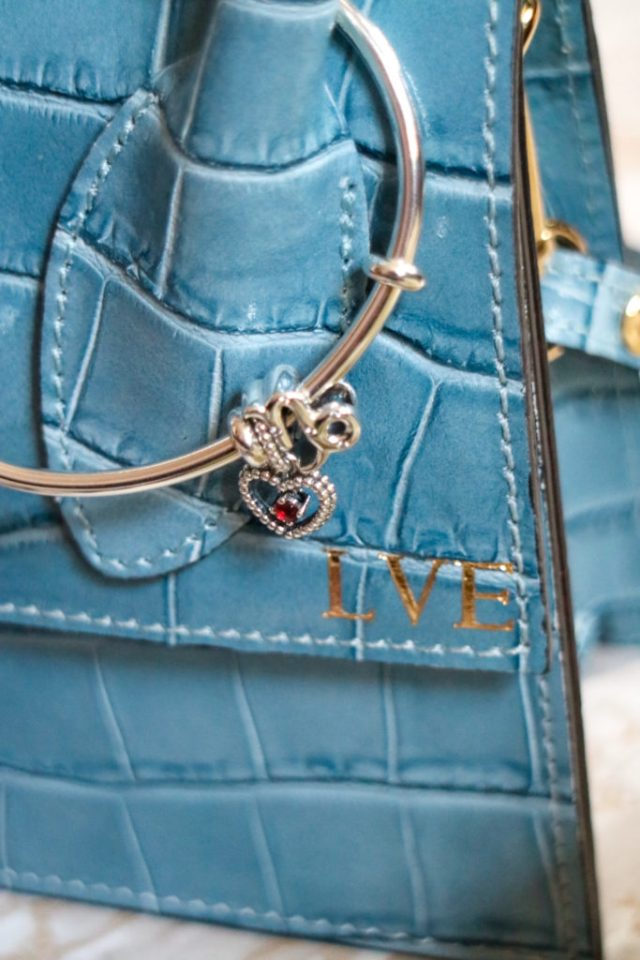 Pandora open bracelet with zodiac and birthstone charms and personalised Azurina Palm Springs Blue Bag