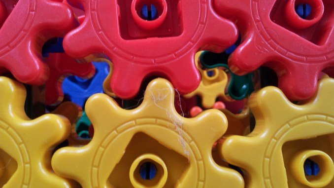 red and yellow plastic cogs