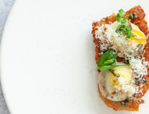 pork-schnitzel-with-le-gruyere-aop-reserve,-quail-eggs,-capers-and-anchovies