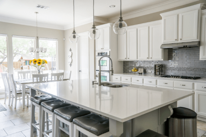 a bright kitchen with white cabinets