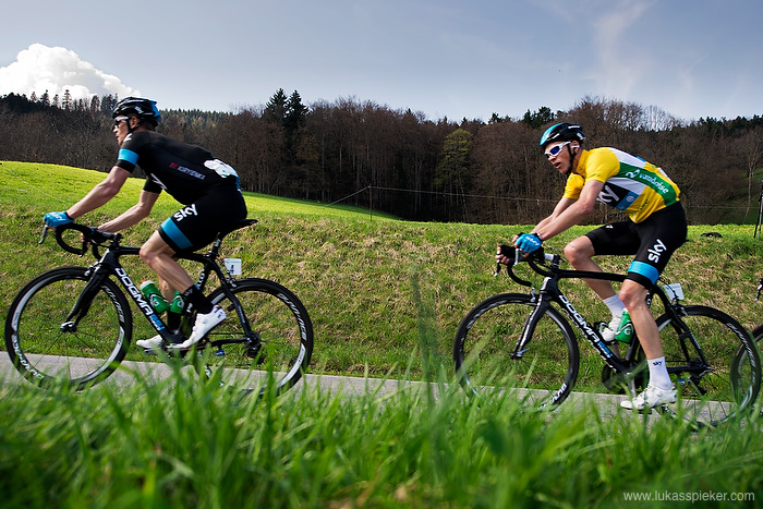 Christopher Froome wearing the yellow jersey and Vasil Kiryienka of Team Sky lead the pack at the ascent to the Col du Mollendruz in the Tour de Romandie April 24, 2013.