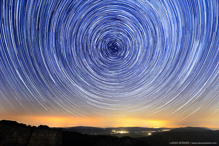 The night sky above Les Ponts-de-Martel in the Jura mountains in Switzerland shows thousands of stars on August 15, 2013. For the photo, multiple long exposures were combined to show the rotation of the earth creating star trails.