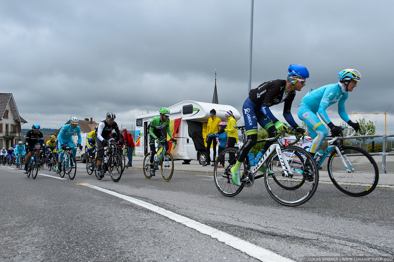 Michael Albasini races at the front of the pack through Arconciel during the 4th stage of the Tour de Romandie in Switzerland May 3, 2014.