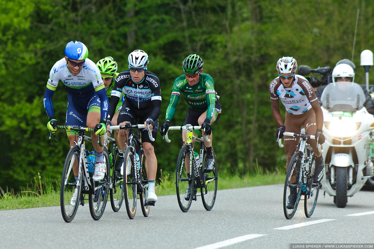 The leading group with Michael Albasini and Thomas Voeckler ascend to Arconciel during the 4th stage of the Tour de Romandie in Switzerland May 3, 2014.