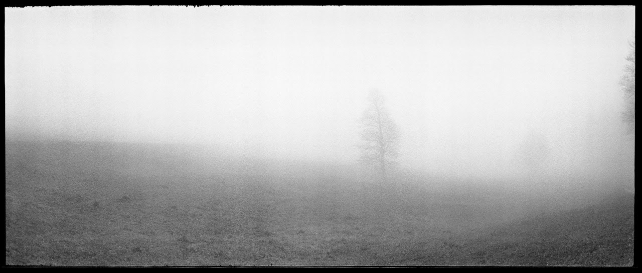 Mist in Jura, photographed with the Horizon swing-lens panoramic camera on Kodak Tri-X 400 black and white film.