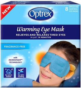 A light blue rectangular box that has an oval logo and optrex warming eye masks written in large bold writing and relieves and relaxes tired eyes written in smaller white writing on it next to a woman wearing a light blue eye mask, on a white background.