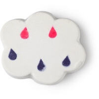 A chunky white cloud shape bath bomb that has some different coloured water droplets on it, on a white background.