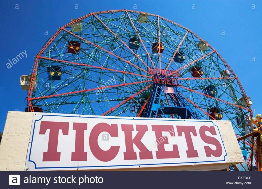 A bright Red Metal Ferris Wheel behind a white rectangular banner that has Tickets written in bold Red writing on it, on a white background.
