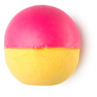 A red and yellow spherical shaped bath bomb, on a white background.
