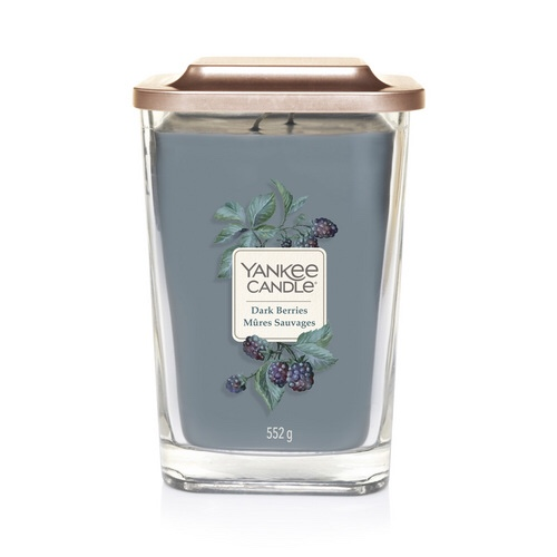 A tall rectangular clear glass jar with a square gold lid full of some dark blue wax with a label that has Yankee Candle Dark Berries written in bold black writing and a picture of some Blackberries on it, on a white background.