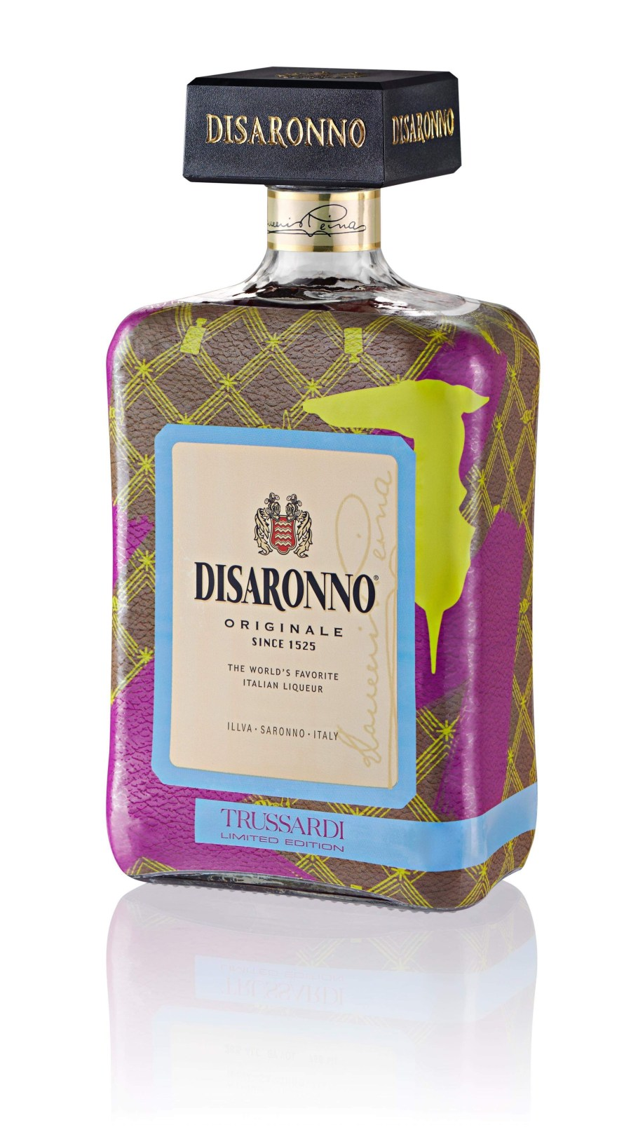 A short brown glass bottle with different coloured splodges all over it and a brown rectangular lid full of some amber coloured liquid with a label that has disaronno since 1525 written in bold black writing on it, on a white background.