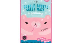 A tall rectangular white plastic pouch that has Jiinju bubble sheet mask written in dark Blue writing and a picture of a pink and tan bear on it, on a white background.