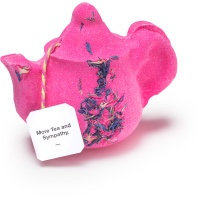 a large bright pink teapot shaped bath bomb that has some Blue Cornflower Petals embedded on it, on a white background.