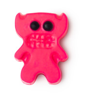 A bright pink demon shaped block of oil that has some bright pink horns and some black eyes on top of it, on a white background.