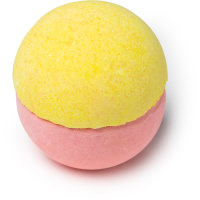 A large spherical shaped bath Bomb that has a yellow top and a Pink bottom, on a white background.