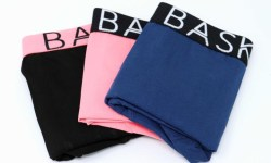 A pair of black boxers with a black waistband that has Bask Menswear written in bold white writing on it next to a pair of Navy Boxers with a black waistband that has Bask Menswear written in bold white writing on it and a pair of coral boxers with a black waistband that has Bask Menswear written in bold white writing on it, on a white background.