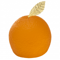 A large circular orange shaped block of bright orange soap with a bright green leaf on top of it, on a white background.