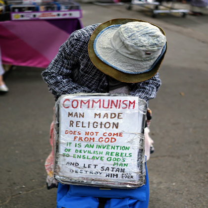 Woman with poster against communism