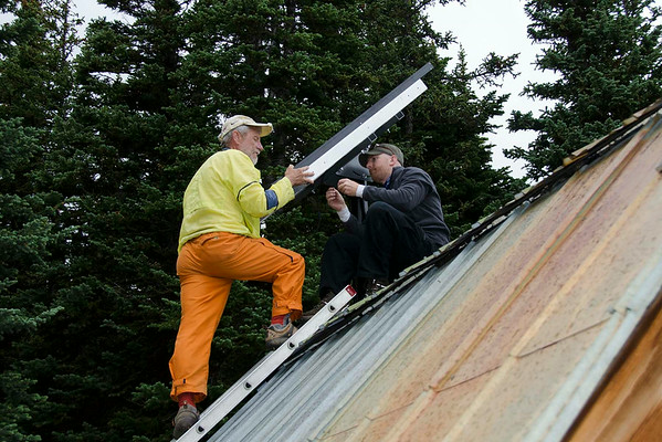 Steve and Ray attaching the solar panel