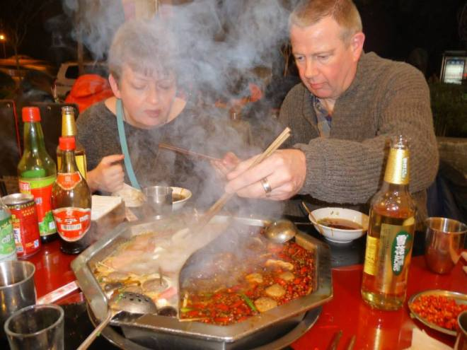 Trying hard to enjoy Sichuan's traditional hot pot